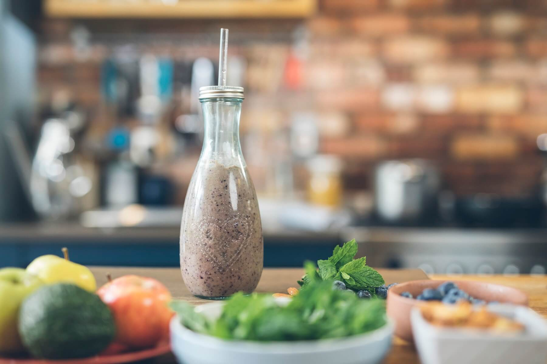 Winter Immune Booster Smoothie in jar with straw
